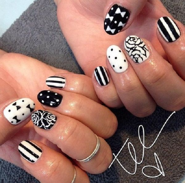This nail design is a variety of bow, stripes, polka dots and flower nail art. What's wonderful about this combination is that the complement each other and the black and white color scheme are simply perfect.
