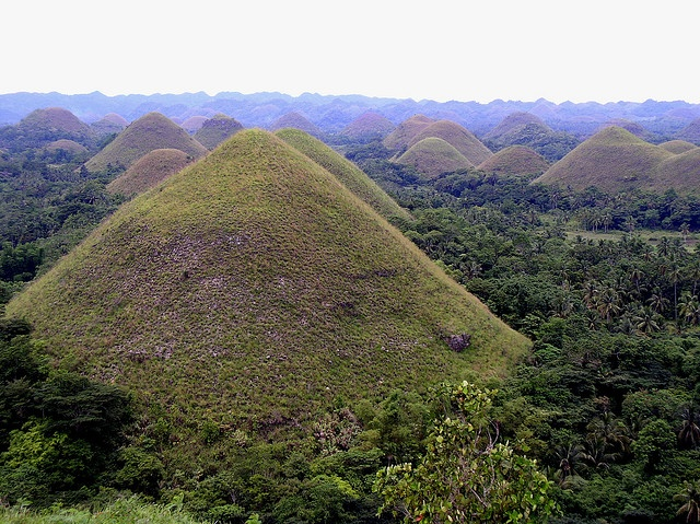 "Bohol Island, Philippines - Hundreds of limestone ""domes"" closely grouped together and covered in grass that turns brown in the dry season hence the name ""The Chocolate Hills"""