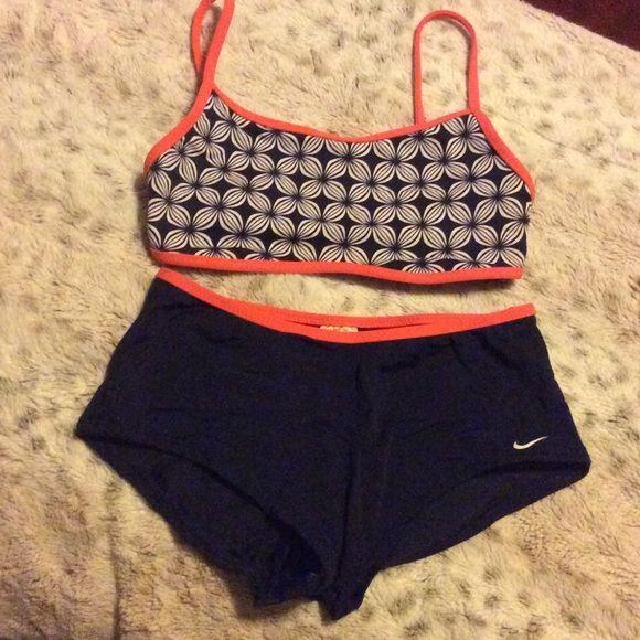 Nike orange and navy bikini Nike orange and navy bikini with reversible tank style top and boy short bottoms. Very lightly worn and great for water sports! Nike Swim Bikinis