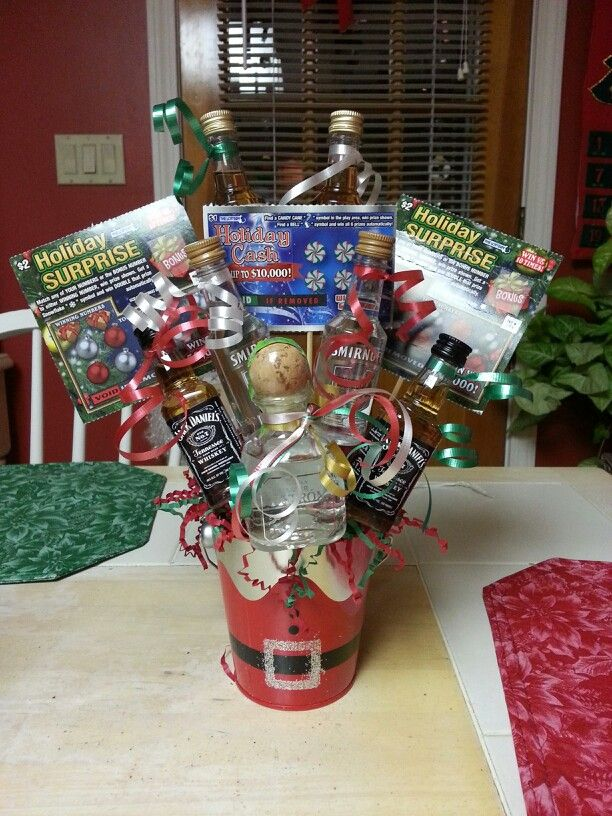 Holiday nips basket for Yankee swap.  Just used hot glue, tape, ribbon, skewers and flower foam.