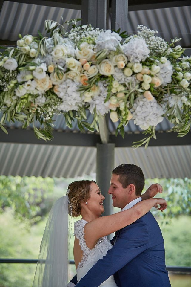 Garden wedding ceremony with hanging floral arrangement  ~Mike Semple Wedding Photography ~