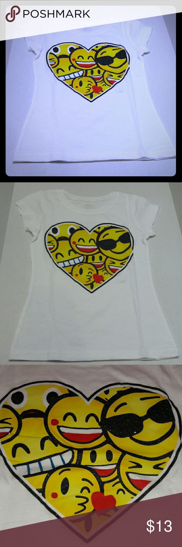 Heart Emoji shirt White super soft short sleeve heart emoji shirt... the heart and all the Emojis where the black is has a glitter over it...11 faces in all (All shown in pic #3)...PERFECT for your little stylish sweetheart...Bundle and save :) Other
