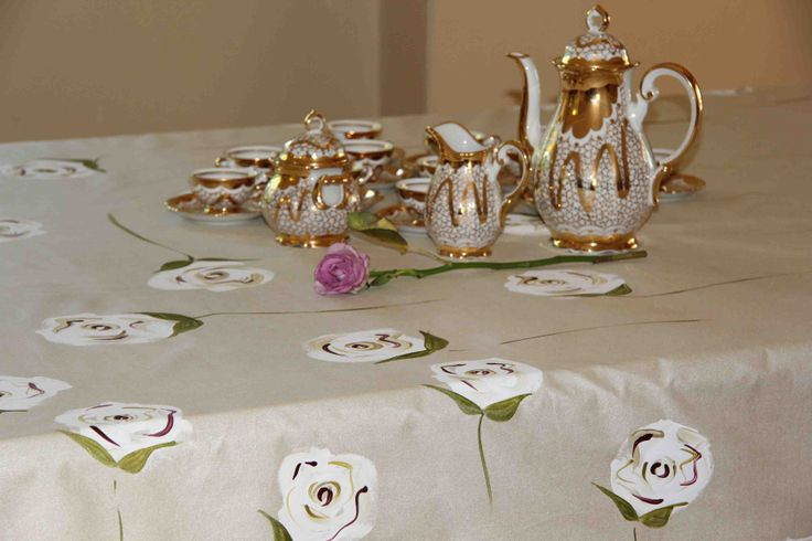 Enjoy a beautiful hand painted table cloth by Dana. www.dmgdesigns.co.za. White roses with cranberry and gold on a shimmery creamy gold backround.