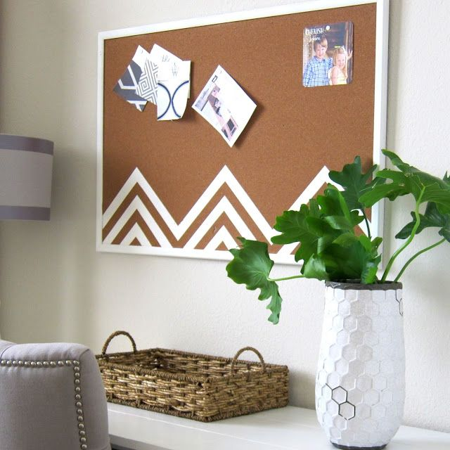 """Cork memo boards ensure our to-dos get """"to-done,"""" but they don't have to look utilitarian to work. A few lines of white paint adds unexpected flair to this piece.  Get the tutorial at This Is Happiness »   - Seventeen.com"""