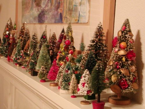 A mini christmas tree forest for the mantel! DECK THE HOLIDAY'S: VINTAGE CHRISTMAS DECORATIONS AND TREES!