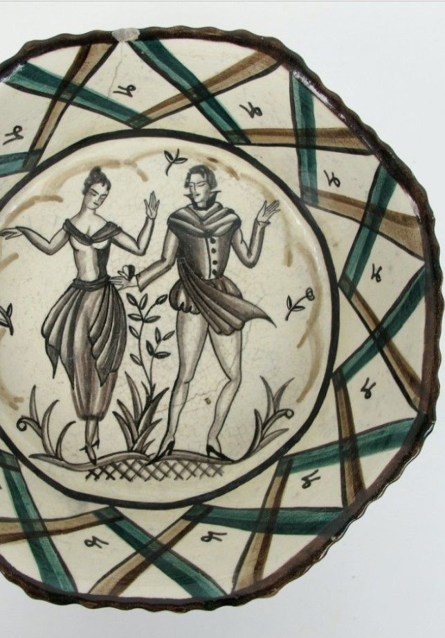 A Wiener Werkstatte Austrian pottery bowl attributed to Hilda Jesser the raised bowl with painted sepia figures in classical dress within borders of diagonal green, black and  brown chevrons, impressed Wiener Keramik marks, 10cm high x 185cm wide  1912 Hilda Jesser attended Vienna School of Applied Arts as a guest student, 1914 becomes full  time student, 1915 admitted to Josef Hoffmann`s architecture classes. Works for the WienerWerkstatte, primarily designing fabrics and fashion until 192