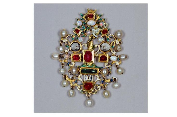 Decorated with onyx, diamonds, emeralds, rubies, opals, and pearls on a gold mount, this pendant is reputed to have belonged to Mary, Queen of Scots. It was presented to HM Queen Elizabeth II in 1977