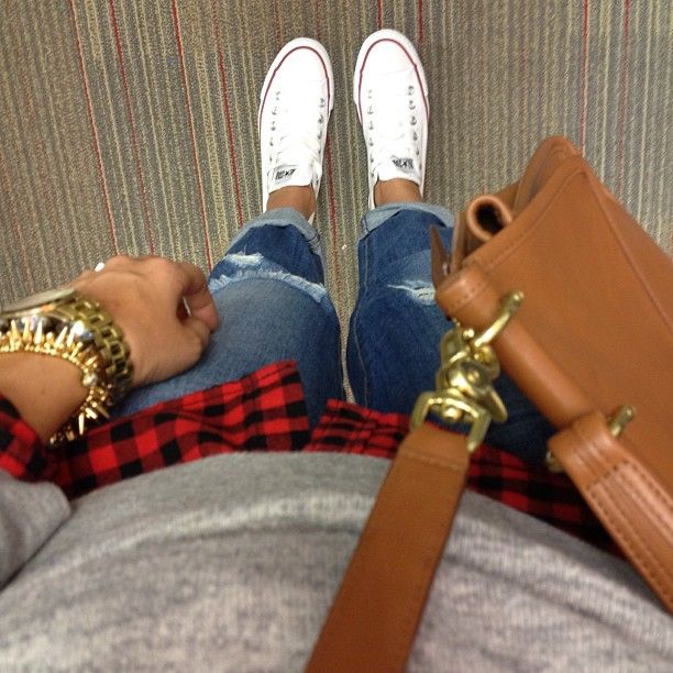Grey sweater, leather bag, black and red gingham button up, distressed jeans and white converse.