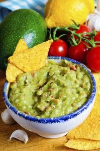 """Guacamole    Always a refreshing snack or side dish, guacamole never goes out of style. Choose the ripest avocados available. They should be soft to the touch like summer tree fruit, without feeling """"hollow inside."""" Under-ripe or hard avocados can ripen after purchase, usually 1-3 days, if left at room temperature. Ripe avocadoes can be held in the refrigerator for 4-5 days without continuing to ripen."""