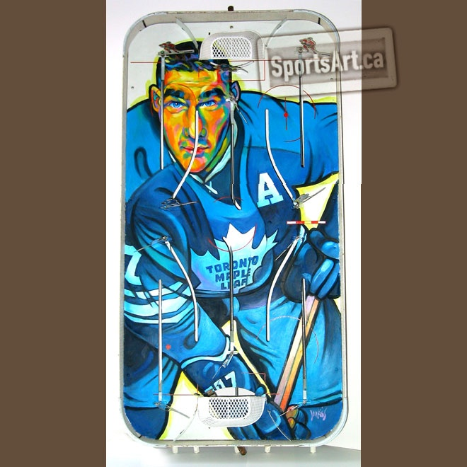 "In his ""Game Faces"" series, Anthony Jenkins honoured Maple Leafs legend Tim Horton with two portraits. The co-founder of the famous coffee shop chain, won four Stanley Cups with the Leafs. Horton played for 24 seasons in a Hall of Fame career."
