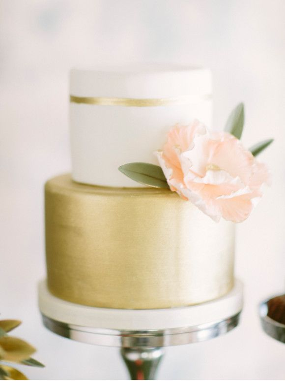 Simple and elegant matte gold wedding cake with a blush sugar flower - love the simple gold band on the top tier!