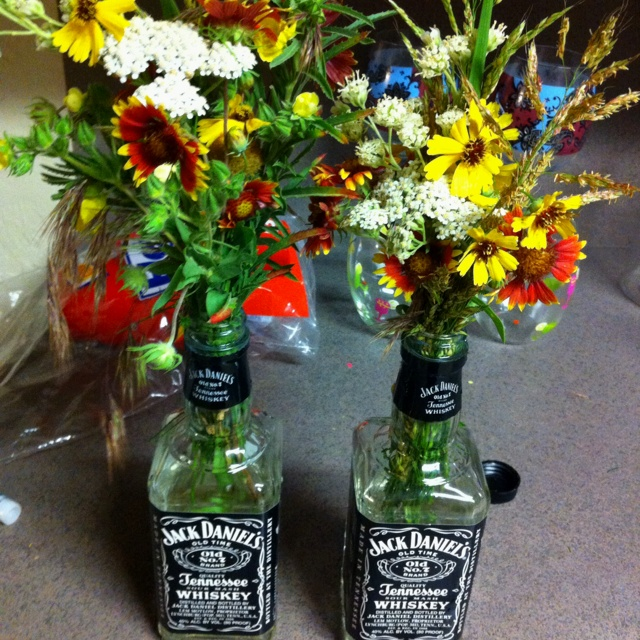 Wildflowers and recycled bottles. = country girls style
