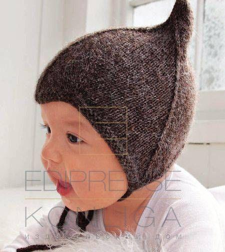 Коричневая шапочка для малыша спицами связанная из теплой и мягкой шерсти. Малышу будет комфортно и красиво. Описание вязания