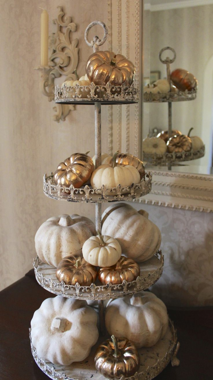 Fall Decor - Gold Painted Pumpkins. With the white pumpkins, you can make a snowman for Xmas.