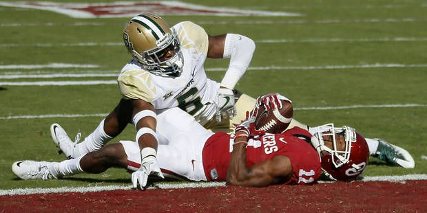 Oklahoma's Dede Westbrook (11) scores a touchdown in front of Baylor's Henry Black (6) during a college football game between the University of Oklahoma Sooners (OU) and the Baylor Bears (BU) at Gaylord Family-Oklahoma Memorial Stadium in Norman, Okla., Saturday, Nov. 12, 2016. Photo by Bryan Terry, The Oklahoman
