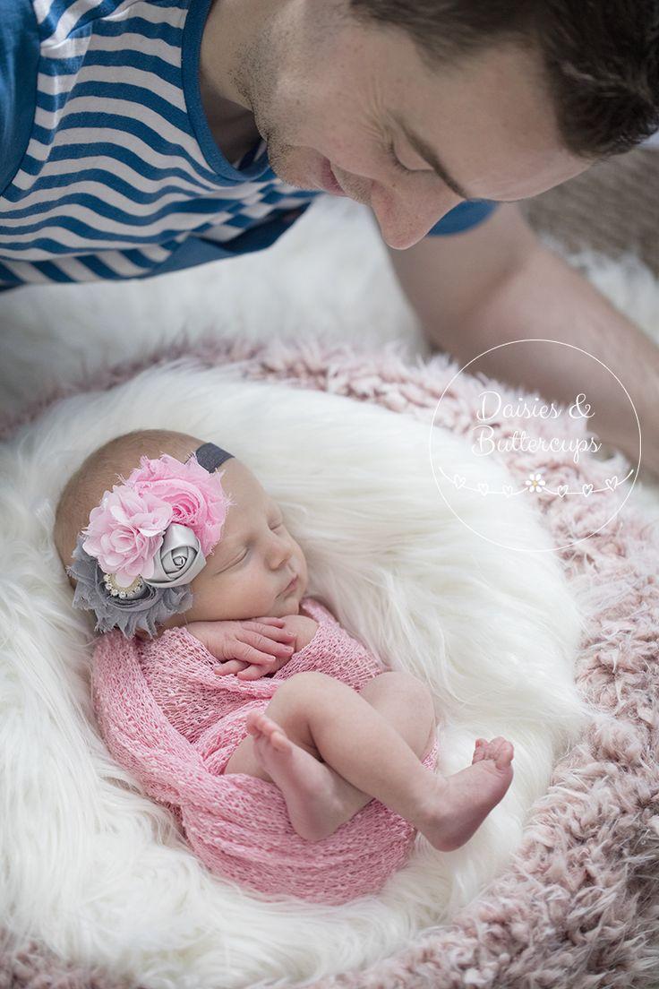 Dad admiring newborn   Daisies & Buttercups Newborn & Family Photography