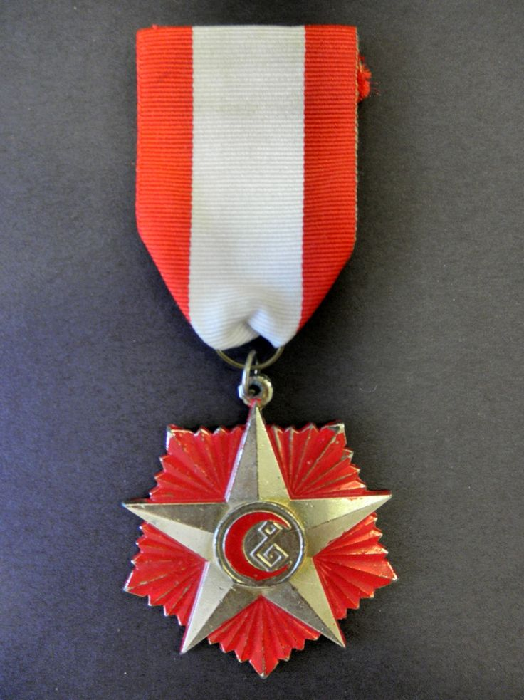 Iraq wound medal the original is pentagon shaped it is unknown if the was a  later