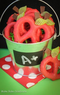 Back to School Treat: Apple Pretzels - Made with Rips Red Candy Melts Large Pretzels Hershey Bar Small leaf cutter of scissors Wax Paper