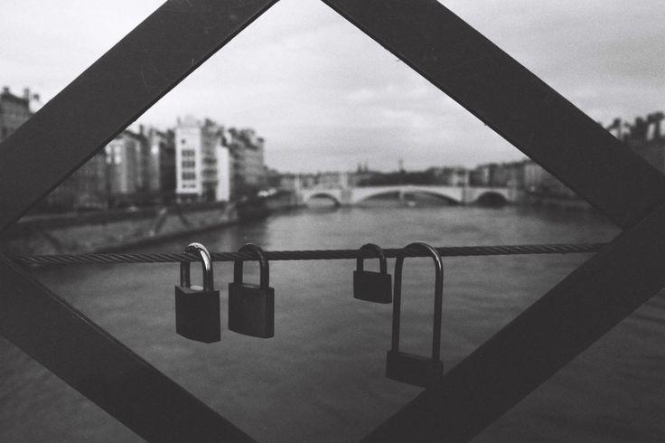 Four padlocks hanged on a bridge cable along the Saone river in Lyon, December 2014 | Credit: Ryan Burton
