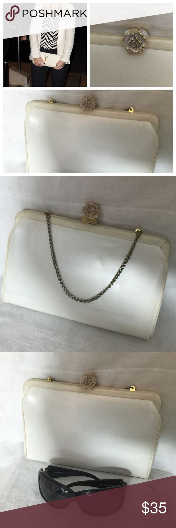 Vintage Rosette Kiss lock Cream Clutch Bag Vintage Rosette Kiss lock Cream Clutch Bag  with little chain strap that can be stored away. This bag is perfect for that vintage wedding dress or to finish off that holiday look. Glasses are for size comparison. Has designer mark inside. Gold tone hardware. vintage Bags Clutches & Wristlets