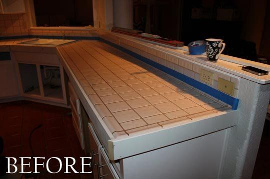 When Cassie and her husband were redoing their kitchen, they were faced with these white tiled countertops. Rather than rip them out, the couple decided to cover them up … with concrete!