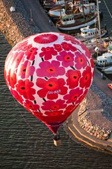 Marimekko Unikko hot-air balloon flying above the silhouette of Helsinki. Marimekko is a Finnish textile and clothing design company renowned for its original prints and colours.  Look the video http://www.youtube.com/watch?v=Vfo6pzfKtkk=player_embedded