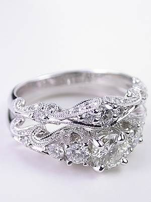 Swirling Diamond Engagement Ring. I only like this in diamond, dont like the colored middle stones