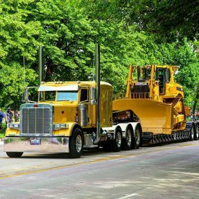 "semitrckn: ""Peterbilt custom 379 heavy haul with a Cat on wagon """