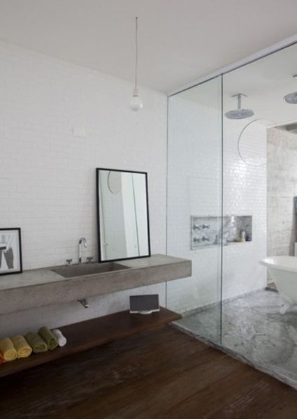 Floating concrete sink with floor to ceiling glass shower/tub combo