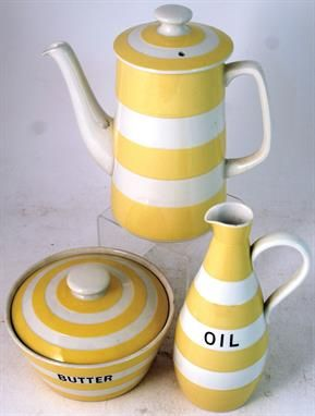 CORNISH YELLOW GROUP. 4 to 7.75ins tall. Coffee pot 'OIL' bottle covered butter dish, (rim chip). Green Shield base mark. (3) NR  From the T G Green family collection