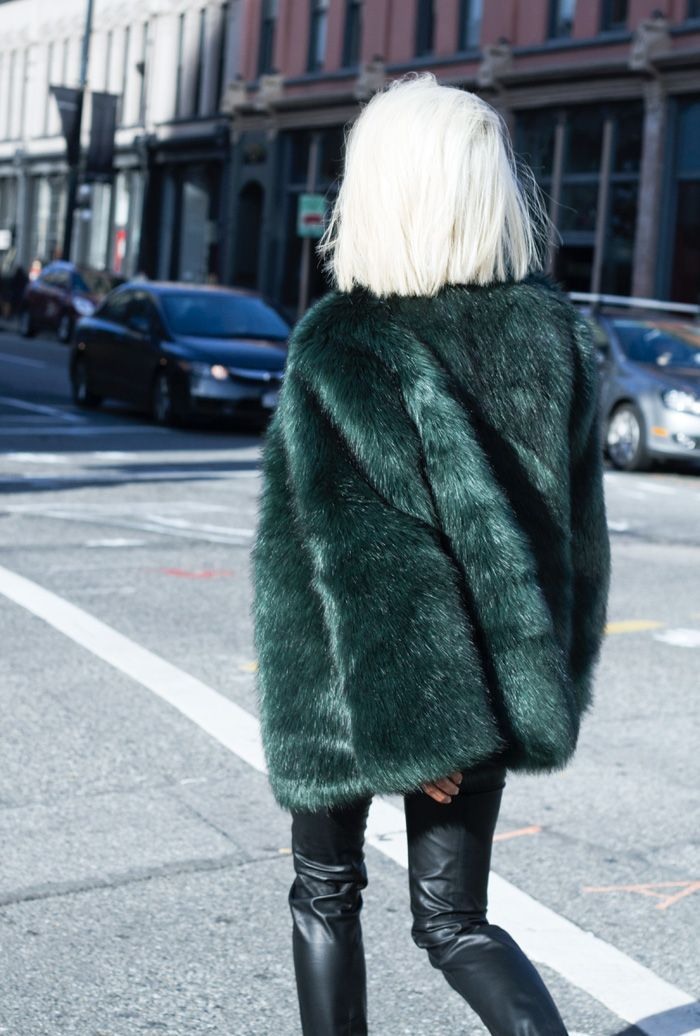Layer up for winter by pairing a jewel tone faux fur coat with leather leggings