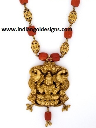 Gold and Diamond jewellery designs: Gorgeous lakshmi pendant temple jewellery nakshi necklace with corals