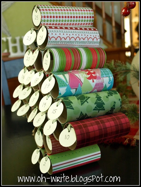 Too cute! Advent tree made from scrapbook paper & toilet paper rolls.