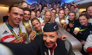 Gold medalists of Team GB pose for a selfie with a member of British Airways…