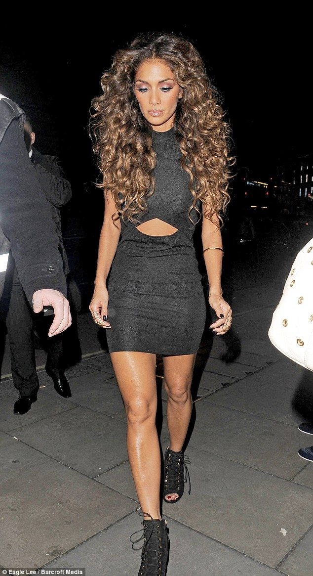 Sch-mazing: Nicole kept her big hair styled perfectly to suit the disco them of the show on Saturday night