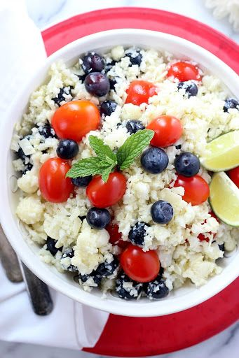 Parmesan Cauliflower Salad With Cauliflower, Fresh Blueberries, Grape Tomatoes, Shaved Parmesan Cheese, Lime, Olive Oil, Oregano, Salt