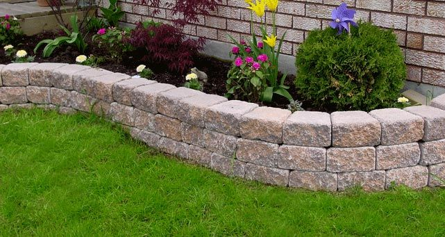 The garden accent retaining wall system is the right - How to build a garden retaining wall ...