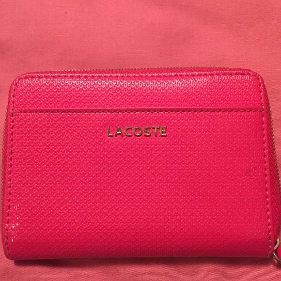 Lacoste Pink Wallet Authentic. Well loved but in great condition. Lacoste Bags Wallets