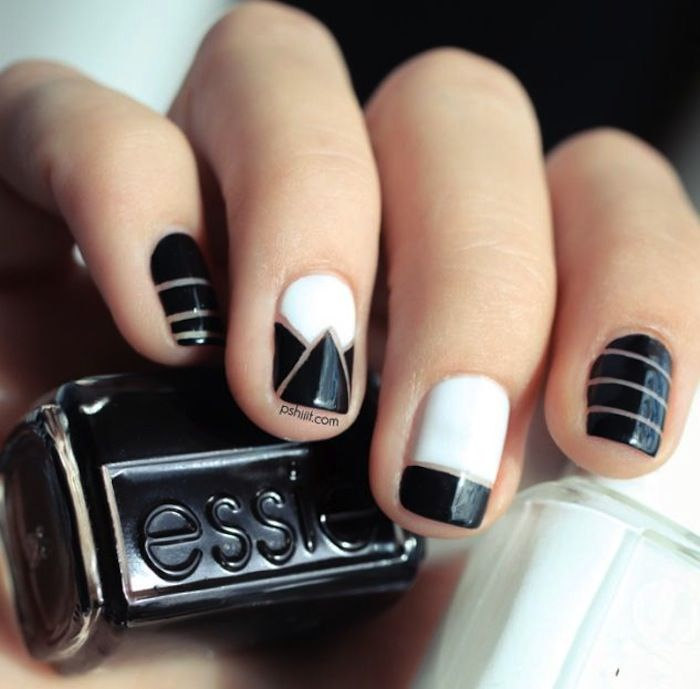 The graphic black-and-white color combo of this manicure keeps the multiple designs from looking too busy. // #nails