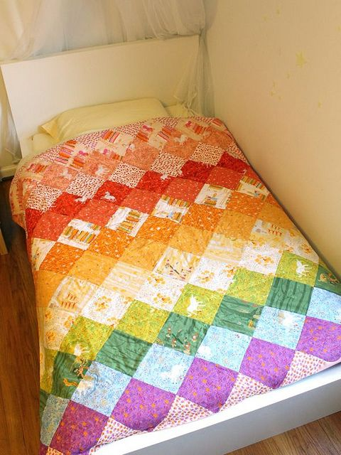 Rainbow Quilt by Rae by madebyrae, via Flickr Great way to use my rainbow charm squares!