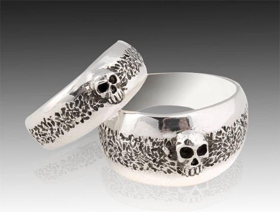 My husband and I NEED these. They are very us..... Matching sterling silver skull wedding ring set.    Custom made to order. Cast in solid sterling silver. Also available in 14K white or yellow