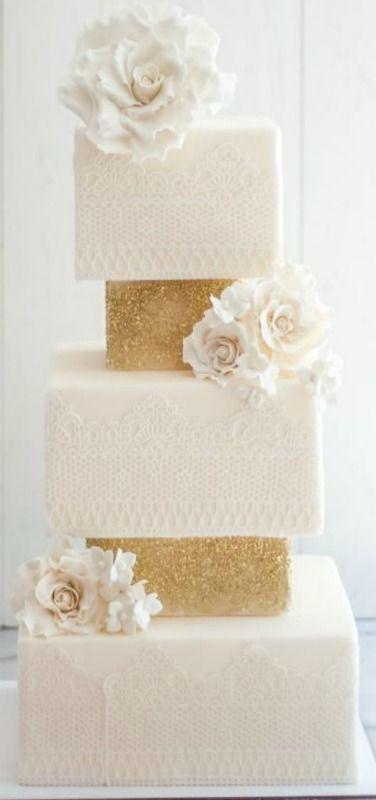 Elegant white and gold wedding cake