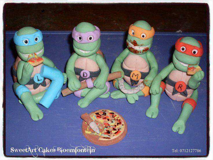 Fondant Ninja Turtles with pizza. Fondant Ninja Turtles with Pizza For more info & orders, email sweetartbfn@gmail.com or call 0712127786.