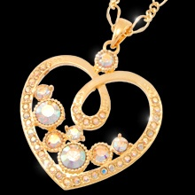 """A Heart Full of Sparkle"" is the perfect gift for your Valentine!  This lovely pendant shimmers with the brilliance of Swarovski crystal as it falls gently from a fine open-loop chain.  17"" neckpiece with 2"" extension  Nickel and lead free  Price:  $84.95"