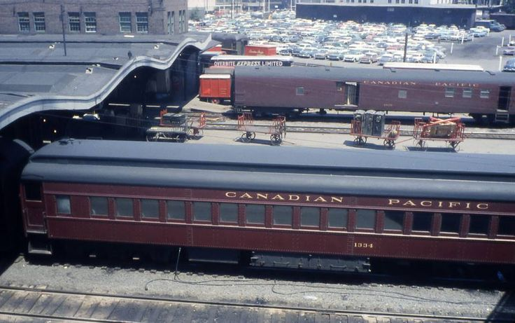 While we are on the subject of trains ... here we are looking down from the Mackenzie King Bridge at the end of the train sheds at Union Station. It was under these sheds that you boarded your train from Ottawa to Parts Beyond.  Date is about 1959, judging by the cars in the parking lot.