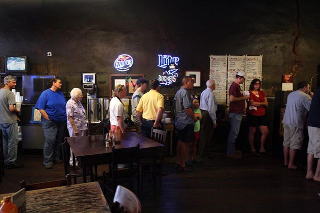 Customers wait in line at Louie Mueller Barbecue in Taylor. (Photo ©Chris Wilkins/Texas BBQ Posse)        I don't know if Ross Perot likes barbecue. He's Texan, so probably. But it doesn't really matter.    He had the perfect term