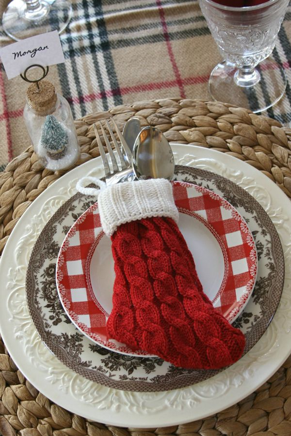 """I love that this """"Burberry"""" pattern crosses over so easily into Christmas and winter. This fun little stockingthat holds silverware and the little snow globe place card holder are new!"""
