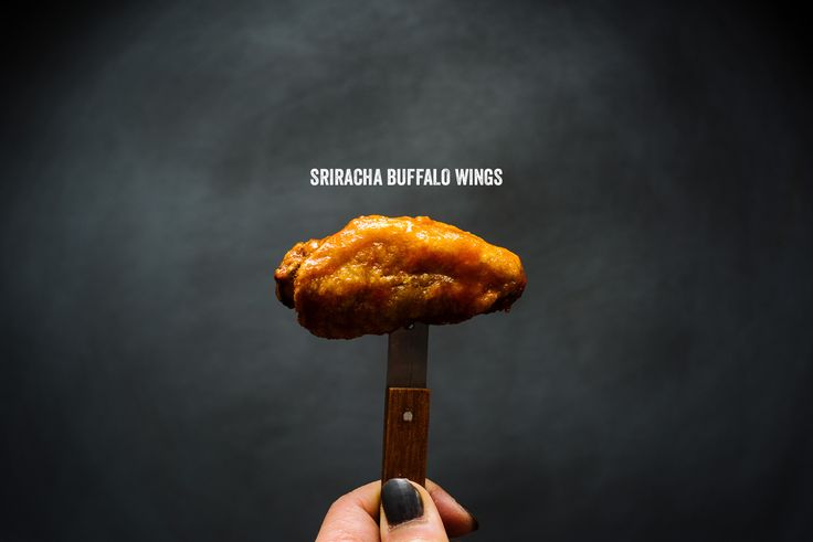 Crispy oven baked wings doused in spicy sriracha buffalo sauce