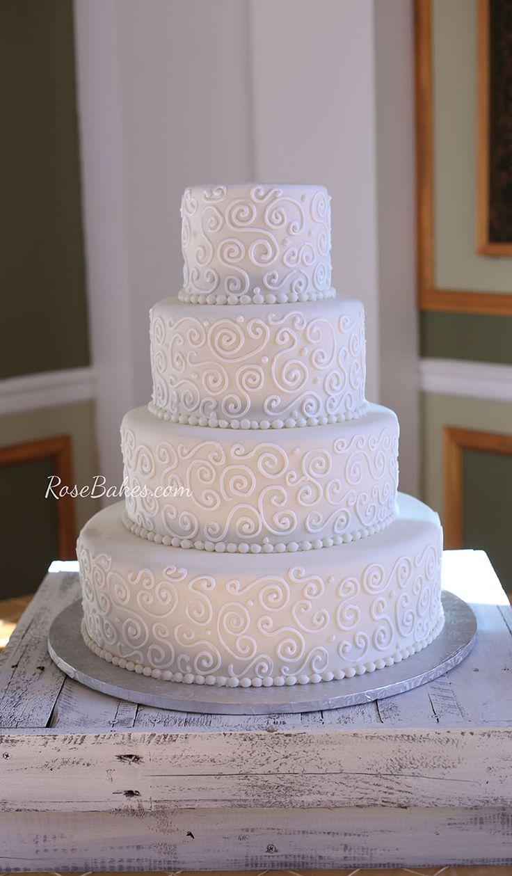 White stuff gateaux apron - All White Scrollwork Wedding Cake