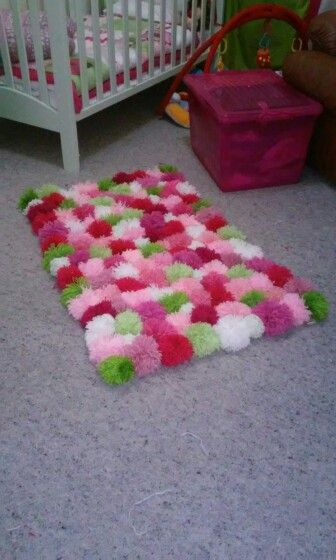Finished pom pom rug for my daughters nursery